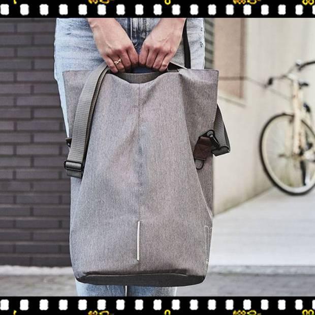 basil city shopper szürke biciklis táska kézben