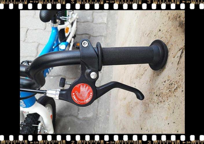 woom2 14-es méretű kék gyerek bicikli fékkar