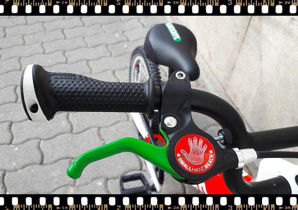 woom2 14-es méretű piros gyerek bicikli fékkar